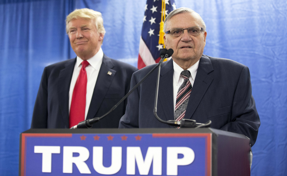 In this Jan. 26, 2016, file photo, Republican presidential candidate Donald Trump is joined by Maricopa County, Ariz., Sheriff Joe Arpaio during a new conference in Marshalltown, Iowa.
