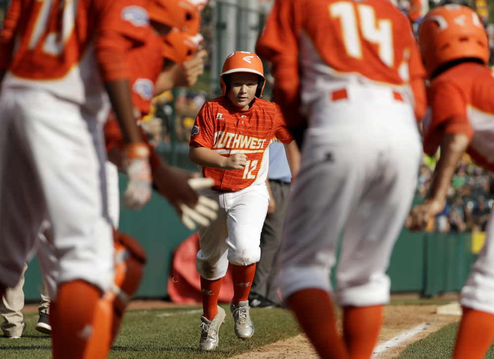 Clayton Wigley rounds the bases after hitting a home run for Lufkin, Texas, in the U.S. championship game Saturday at the Little League World Series in South Williamsport, Pa. Lufkin won, 6-5.