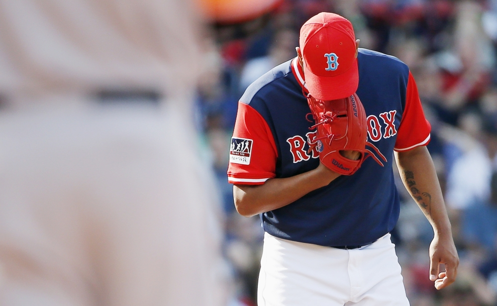 Boston's Eduardo Rodriguez stands on the mound after giving up an RBI single to Baltimore's Mark Trumbo in the second inning of the Red Sox' 7-0 loss to the Orioles on Saturday in Boston.