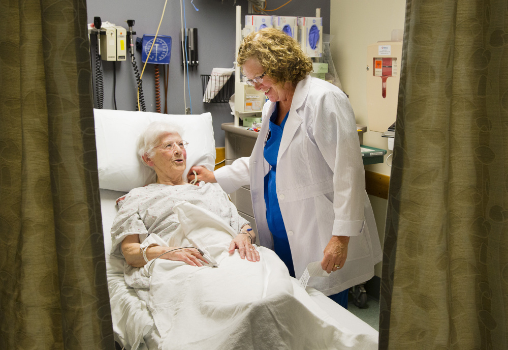 Emergency Room nurse Katie Johnson looks after Sister Margaret Cushman at Mercy Hospital in Portland recently. Administrators at both Mercy and Maine Medical Center say they're working on long-term solutions to the growing shortage of nurses, including innovative recruitment programs.