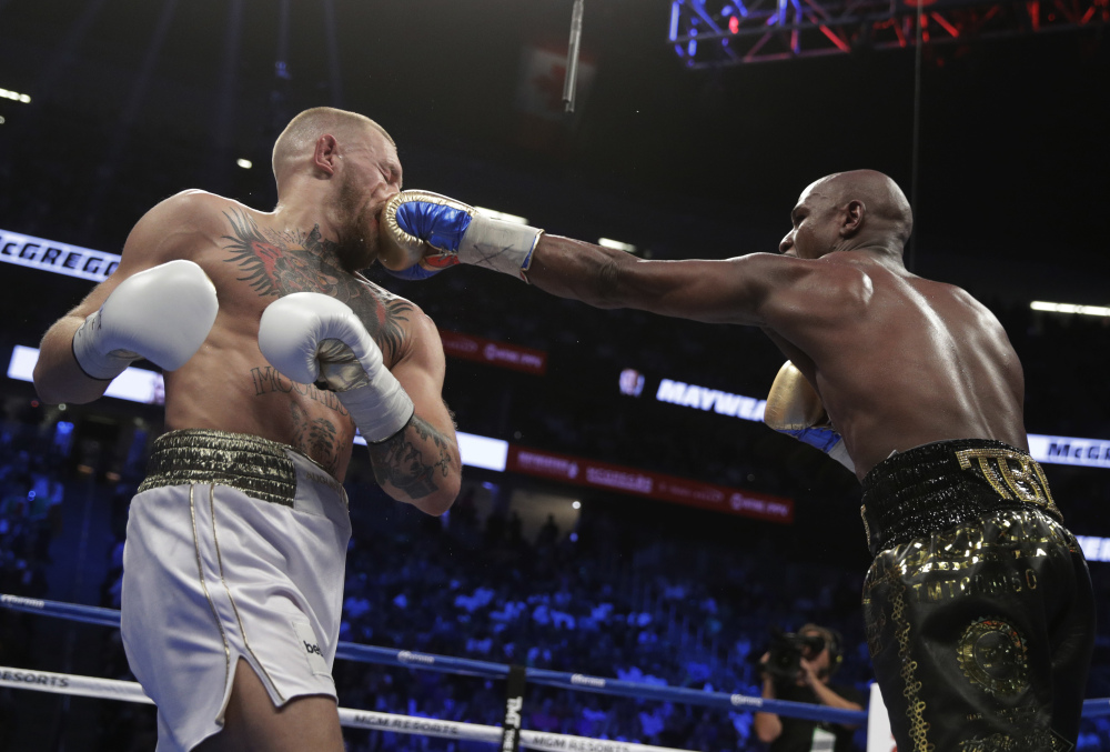 Floyd Mayweather Jr. jabs Conor McGregor. McGregor, in his first professional boxing match, made it into the 10th round before the referee stopped the fight.