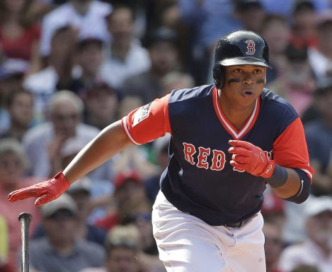 Red Sox's Rafael Devers runs after hitting an RBI double off a pitch by Baltimore Orioles' Mychal Givens as Orioles' Welington Castillo looks on in the sixth inning Sunday in Boston.
