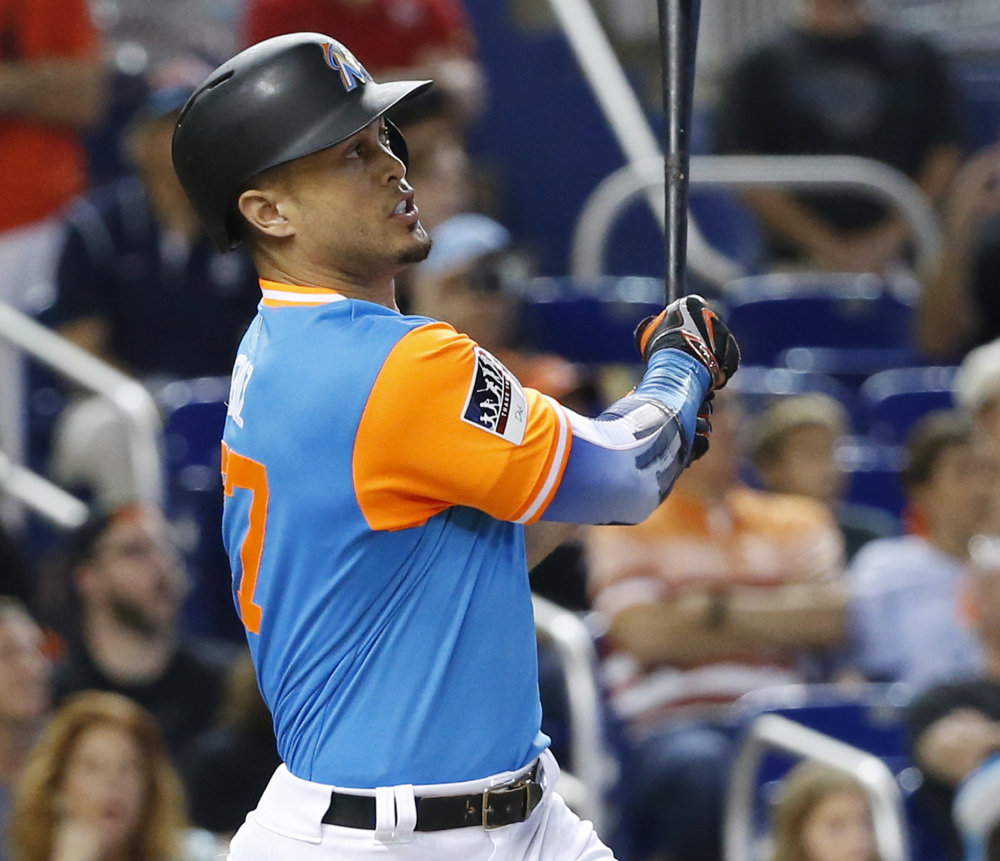 Giancarlo Stanton of the Marlins watches his 50th home run of the season, which broke an eighth-inning tie against the Padres on Sunday in Miami.