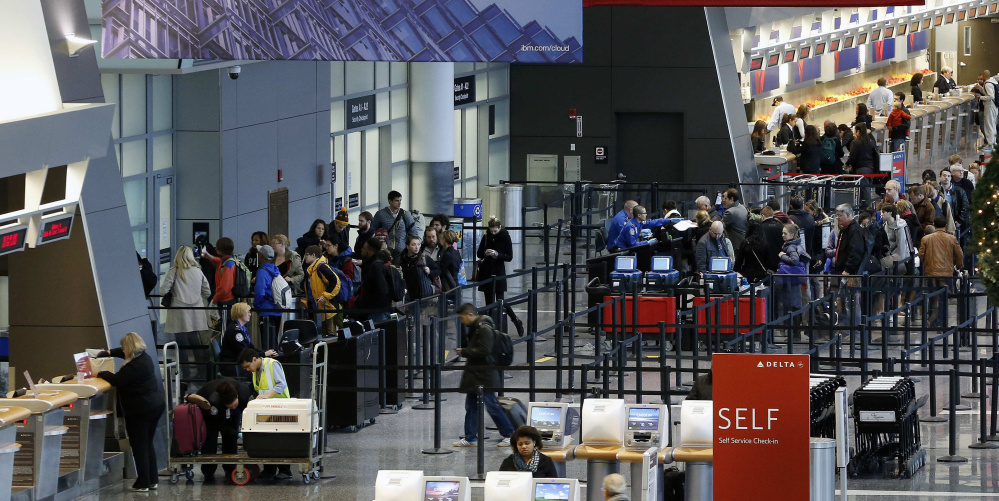 Passengers line up at the security checkpoint in terminal A at Logan International Airport in Boston.