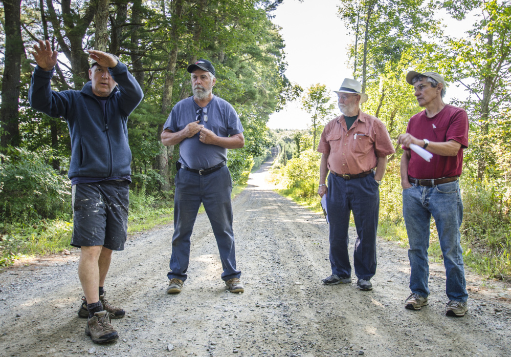 Whitefield town officials and residents gather Monday on Hollywood Boulevard to discuss the removal of trees to enhance road safety and improve drainage. From left are: Chris Hamilton, who lives on the road, Road Commissioner David Boynton and Selectmen Frank Ober and Tony Marple.