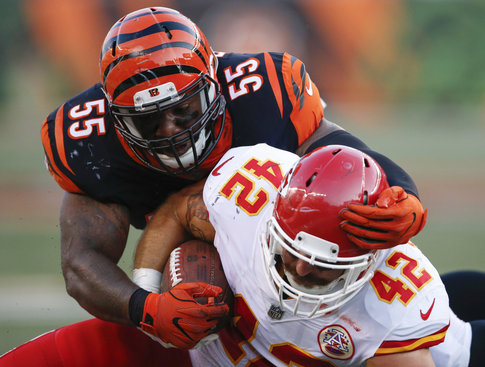 Bengals linebacker Vontaze Burfict tackles Chiefs fullback Anthony Sherman during a game earlier in the preseason. Burfict, who has a history of illegal hits, was suspended five games for a hit on Sherman in the same game.