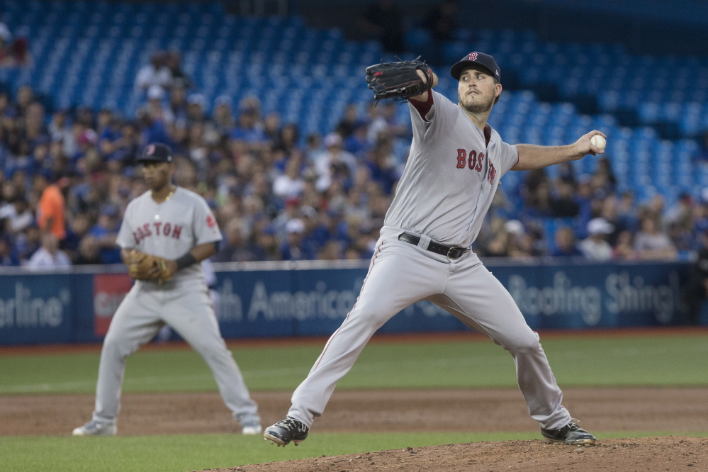 Red Sox starter Drew Pomeranz works against the Blue Jays in the second inning Monday night. He went six innings and improved his record to 14-4.