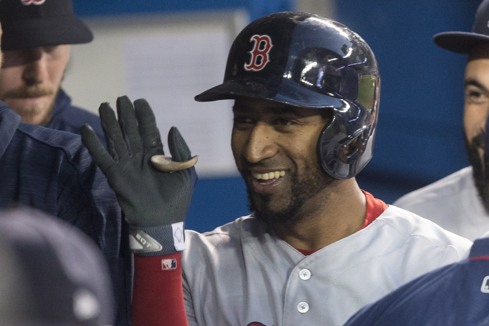 Red Sox second baseman Eduardo Nunez celebrates in the dugout after hitting a solo home run in the third inning.