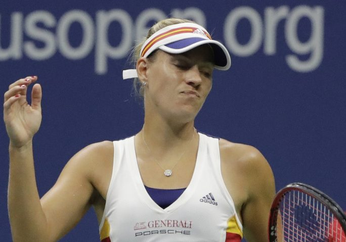 Angelique Kerber became only the second defending U.S. Open champ to lose in the first round Tuesday, falling in straight sets to Naomi Osaka of Japan.