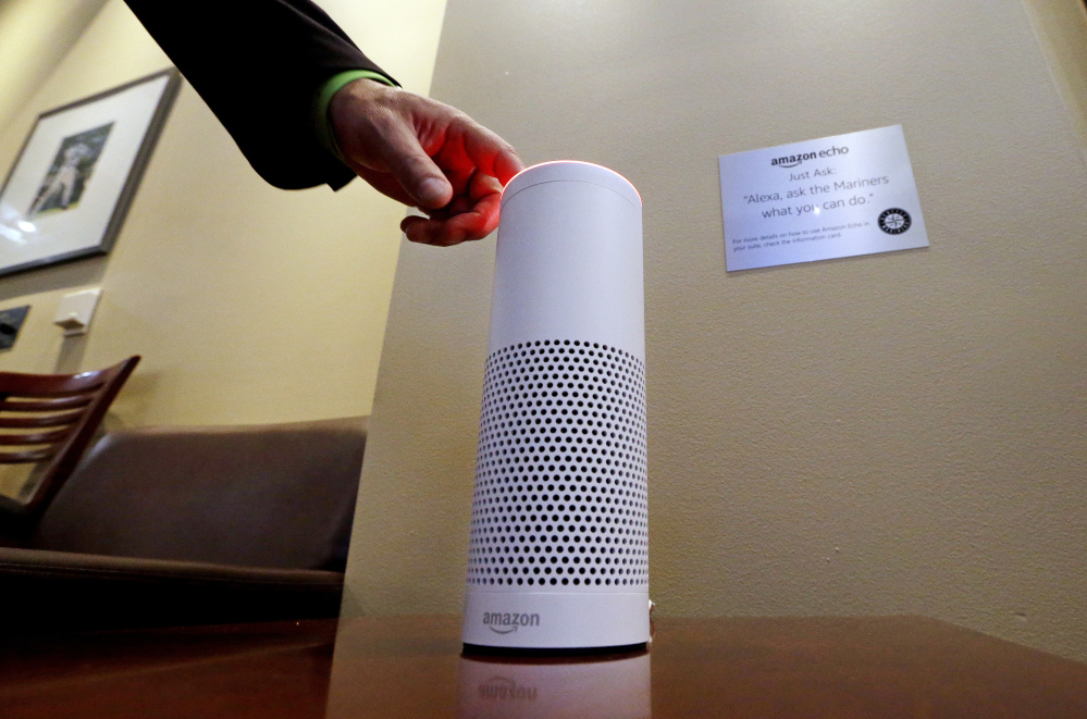 An Amazon Alexa device is switched on for a demonstration of its use in a ballpark suite before a Seattle Mariners baseball game in Seattle. Microsoft and Amazon are making their Alexa and Cortana voice assistants team up and talk to each other in new collaboration.