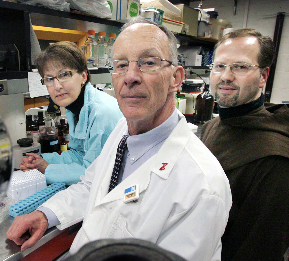 Associated Press/Steven Senne University of Massachusetts professor Dr. James Dobson Jr., center, posses with his wife, Susan, and Teresian Carmelite Prior Dennis-Anthony Wyrzykowski in Dobson's lab at the University of Massachusetts Medical School.