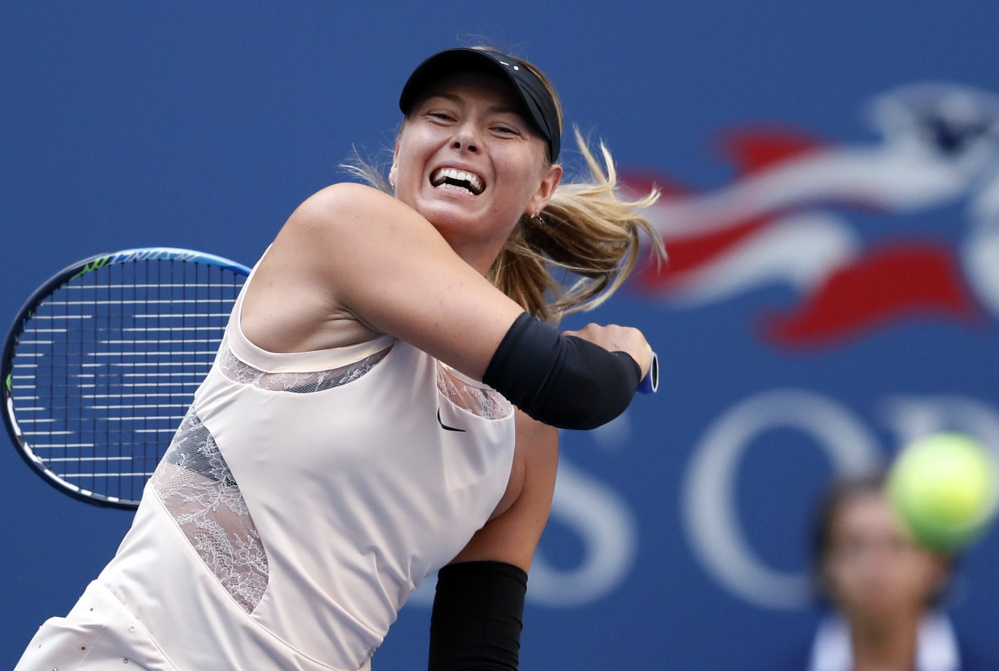 Maria Sharapova became the first player to reach the third round of this year's U.S. Open when she rallied Wednesday for a 6-7 (4), 6-4, 6-1 win over Timea Babo.