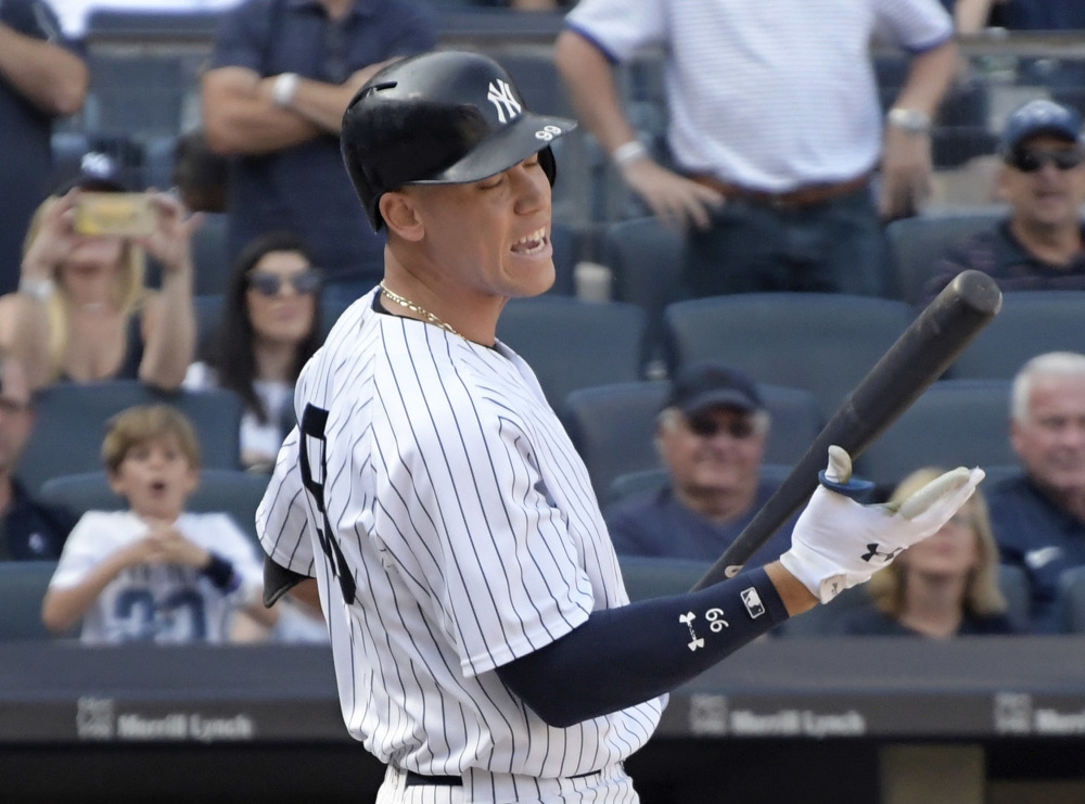 Pinch hitter Aaron Judge reacts after striking out in the ninth inning of the Yankees' 2-1 loss to Cleveland in the first game of a doubleheader Wednesday in New York.