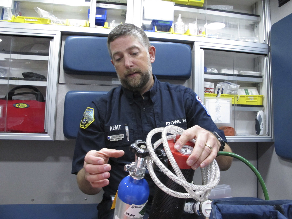 Scott Brinkman, chief of Stowe Department of Emergency Medical Services, demonstrates how nitrous oxide is used in an ambulance, in Stowe, Vt. Several rural ambulance crews are using nitrous oxide, or laughing gas, to treat patients' pain en route to the hospital when paramedics aren't on board to provide narcotics.