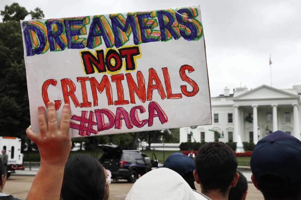 A sign supports the Obama administration program, Deferred Action for Childhood Arrivals, at the White House on Aug. 15.