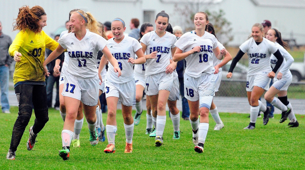 The Erskine Academy girls soccer team celebrates after beating MCI in a Class B North preliminary game last season in South China.