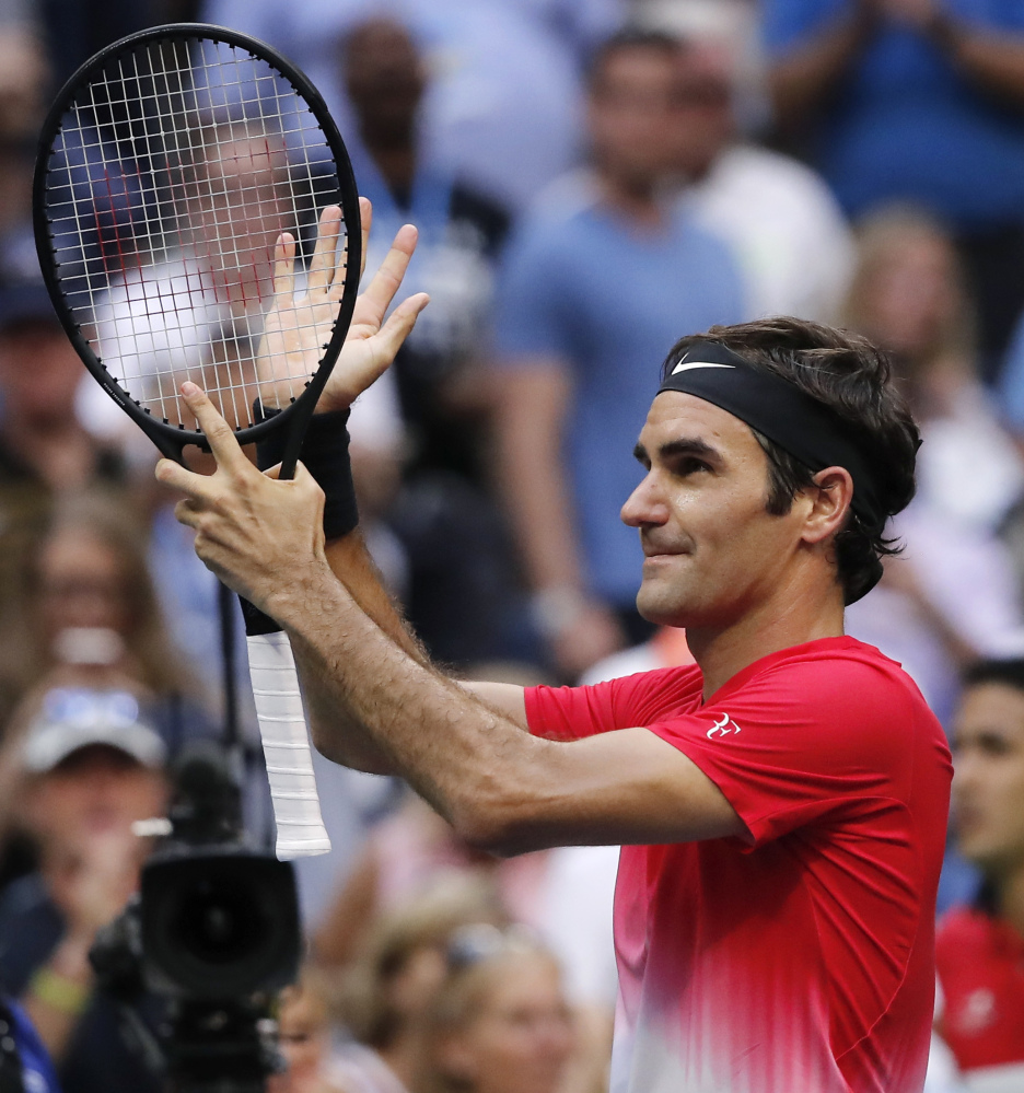 Roger Federer reacts Thursday after defeating Mikhail Youzhny in five sets to advance to the third round of the U.S. Open. Federer was forced to go five sets in each of the first two rounds for the first time in a Grand Slam event.