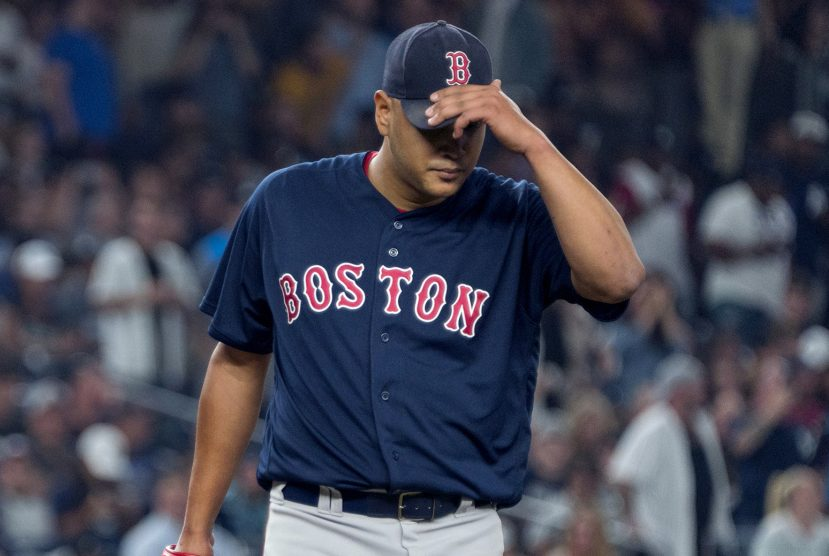 Boston starter Eduardo Rodriguez walks back to the mound between Yankees batters in the sixth inning Thursday night in New York.