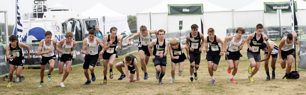 The boys take off at the start of the Beach to Beacon high school mile on Friday.