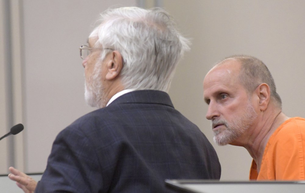 Robert Lonardo, right, speaks Monday with his attorney, Andrews Campbell, during a hearing to appeal Lonardo's life sentence for the 1994 murder of Marianne Pembrook.