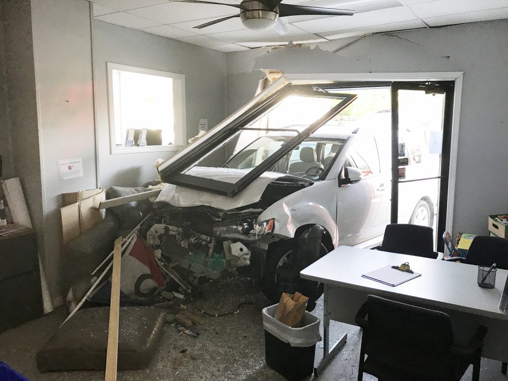A vehicle crashed into Lady's Auto Sales just before 8 a.m. Tuesday after a driver suffered a medical problem.
