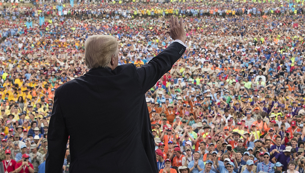 President Donald Trump waves to the crowd after speaking at the 2017 National Scout Jamboree in Glen Jean, W.Va.,on July 24, 2017.