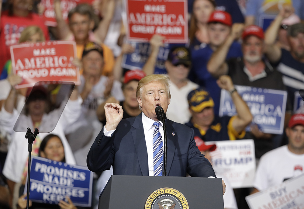President Trump speaks during a rally Thursday  in Huntington, W.Va. Trump overwhelmingly won the state in the November election, partly due to his promises to revive a slumping coal industry.