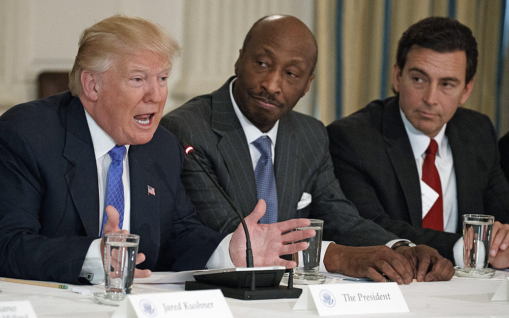 Merck CEO Kenneth Frazier, center, listens to President Trump during a meeting with manufacturing executives at the White House on Feb. 23, 2017. Then-Ford CEO Mark Fields is at right.