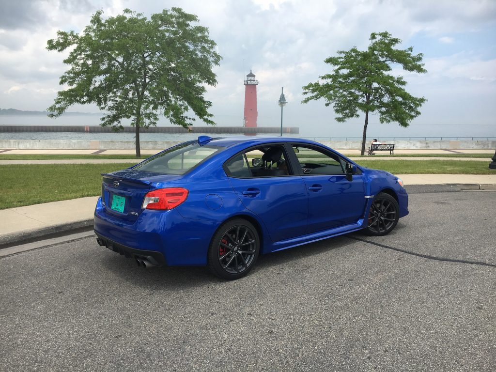 The 2018 Subaru WRX in premium trim and pearl blue paint is a better entry-level sports car than a highway cruiser.