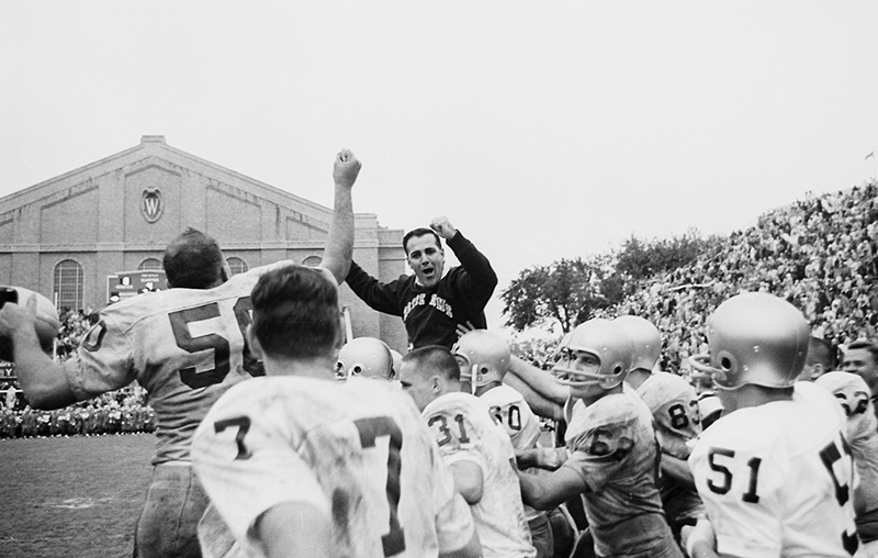 In this Sept. 26, 1964, file photo, Notre Dame coach Ara Parseghian celebrates his first victory with the school as he is carried on the shoulders of his players after their 31-7 victory over Wisconsin, in Madison.