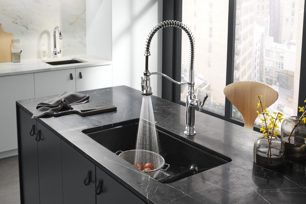 The Tournant faucet by Kohler combines traditional design with modern industrial elements.