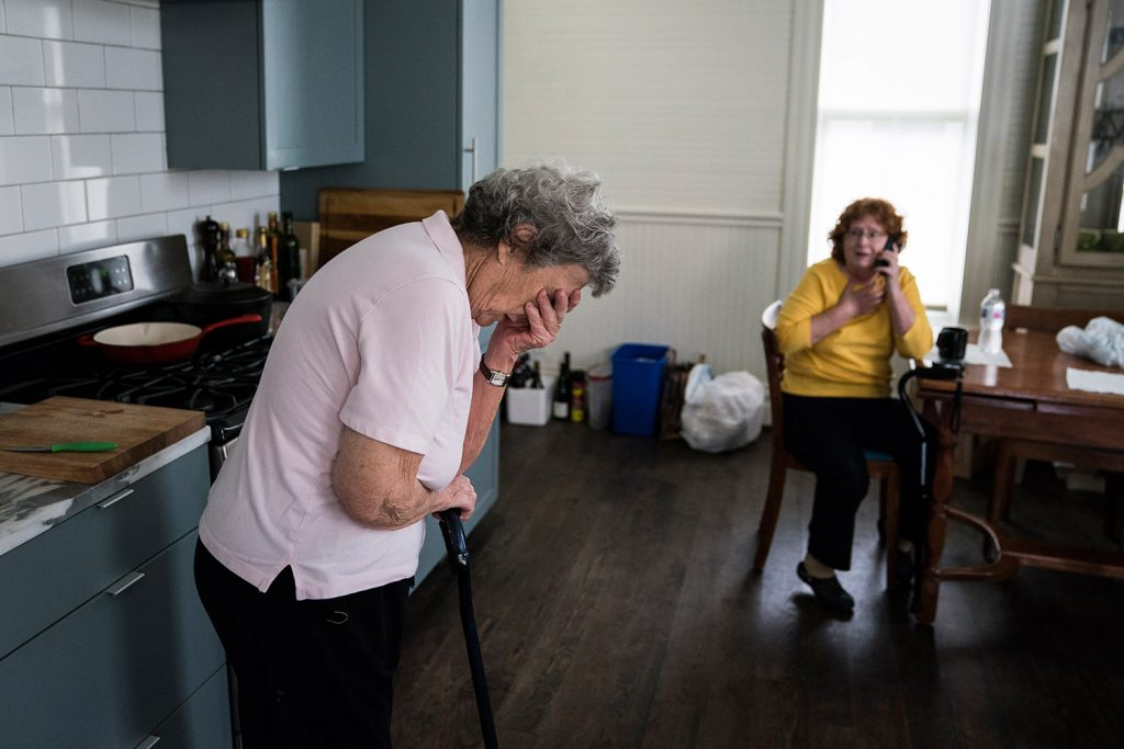 Becky Bain, 58, and her mother Miriam Bain, 82, react as a family member calls to tell them their home survived Hurricane Harvey. They evacuated to a shelter, and are staying in a rental home owned by Anne Whitlock and Michael Skelly in Houston.
