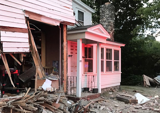 Police say the homeowner was not at home when the truck hit his residence on Main Street in Waterboro.