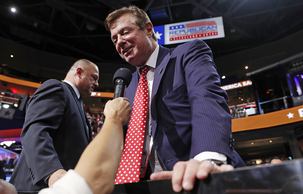 Paul Manafort, then-Republican presidential candidate Donald Trump's campaign manager, talks to the media from the Trump family box on the floor of  the Republican National Convention in Cleveland on July 18, 2016.