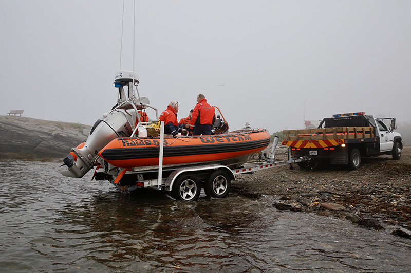 The Cape Elizabeth Water Extraction Team prepares to depart from Kettle Cove in the fog Friday morning.