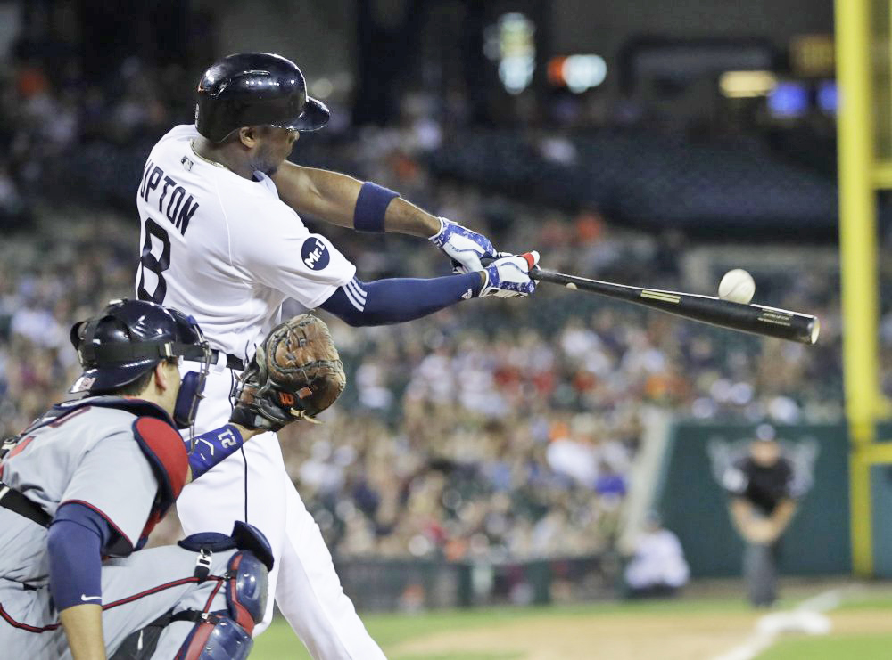 Justin Upton of the Tigers connects for a two-run, walk-off home run in the ninth inning Saturday against the Twins in Detroit. The Tigers blew a 5-0 lead and rallied from an 11-6 hole.