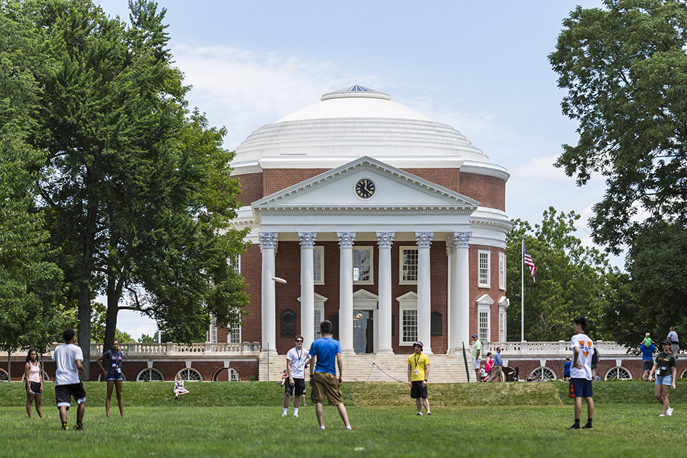 Students play Frisbee on the green in front of the Thomas-Jefferson-designed Rotunda at the University of Virginia on June 26, 2017.
