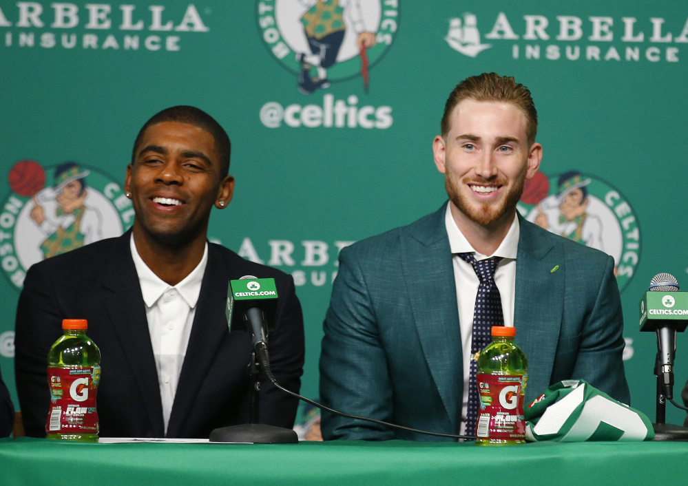 Boston Celtics' Kyrie Irving, left, and Gordon Hayward laugh during a news conference in Boston, Friday, Sept. 1, 2017. (AP Photo/Winslow Townson)
