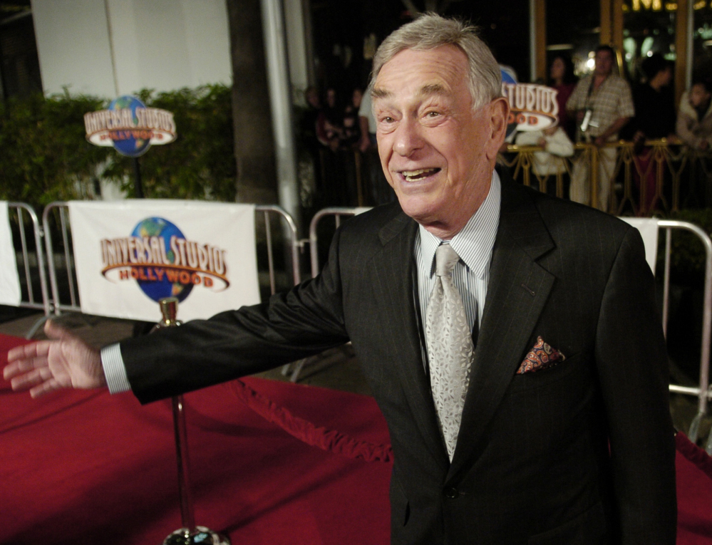 "Comedian Shelley Berman poses at the premiere of the film ""Meet the Fockers"" in Universal City, Calif., in 2004. Berman died Friday at home in Bell Canyon, Calif., at 92."