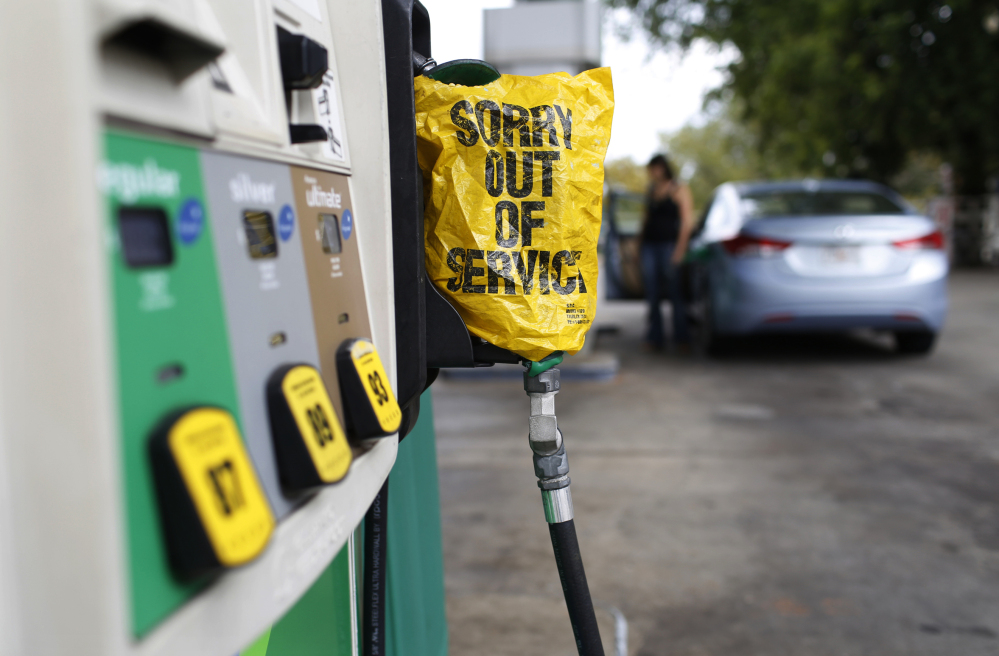 Some pumps, like this one at a gas station in Athens, Ga., and others in parts of Texas went dry Friday. More than one-fifth of the nation's supply has been affected by flooding that hit refineries on the Texas coast.