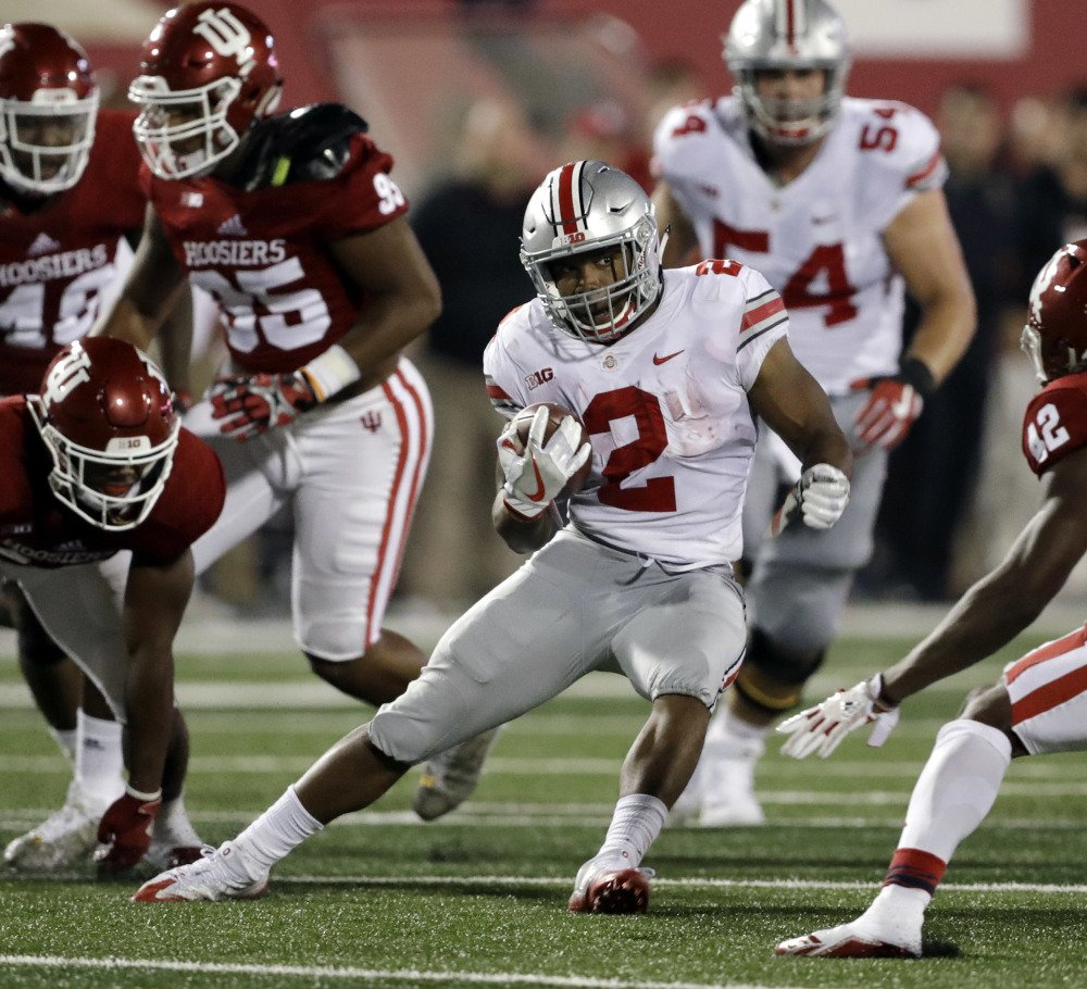 Ohio State's J.K. Dobbins carries against Indiana during the Buckeyes' 49-21 season-opening road victory Thursday night. The freshman ran for 181 yards and could challenge last year's top runner, Mike Weber, for playing time.