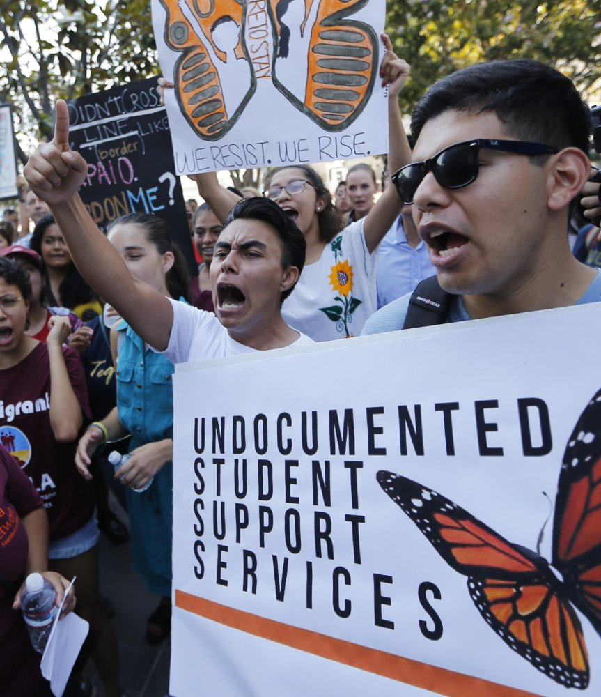 Undocumented students join a rally in support of the Deferred Action for Childhood Arrivals in Los Angeles Friday.