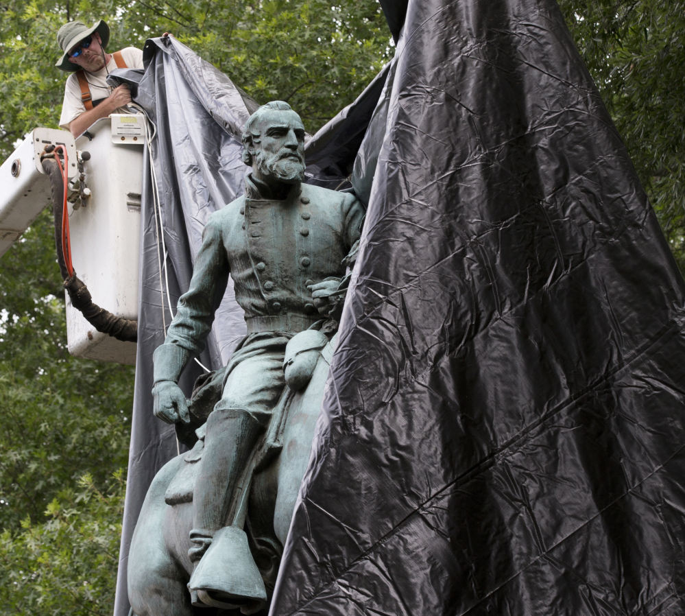 A city worker covers a statue of Confederate general Thomas 'Stonewall' Jackson in Charlottesville, Virginia, last month. It is one of two statues the City Council voted to remove.