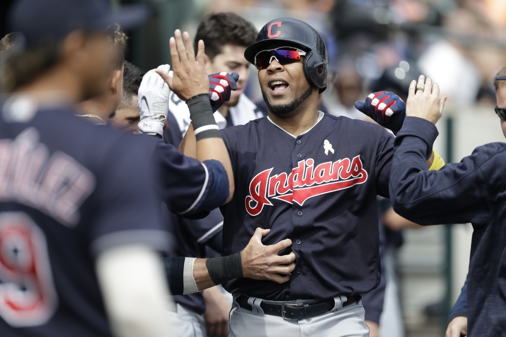 Edwin Encarnacion of the Indians is congratulated after his solo homer in the sixth inning of the first game at Detroit on Friday, a 3-2 Cleveland win. The Indians won the night game 10-0.