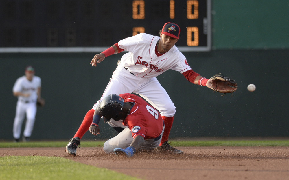 Portland's Deiner Lopez can't reach the ball as J.D. Davis of New Hampshire slides safely into second base with a stolen base during Saturday;s game at Hadlock Field in Portland. The Sea Dogs won, 5-4 in 10 innings.