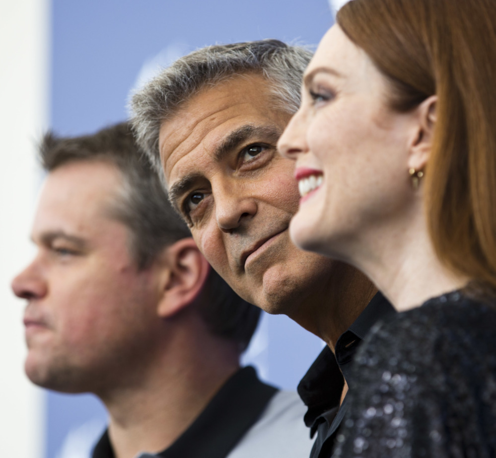 George Clooney, center, poses with Julianne Moore and Matt Damon at the 74th Venice Film Festival in Venice, Italy, on Saturday.