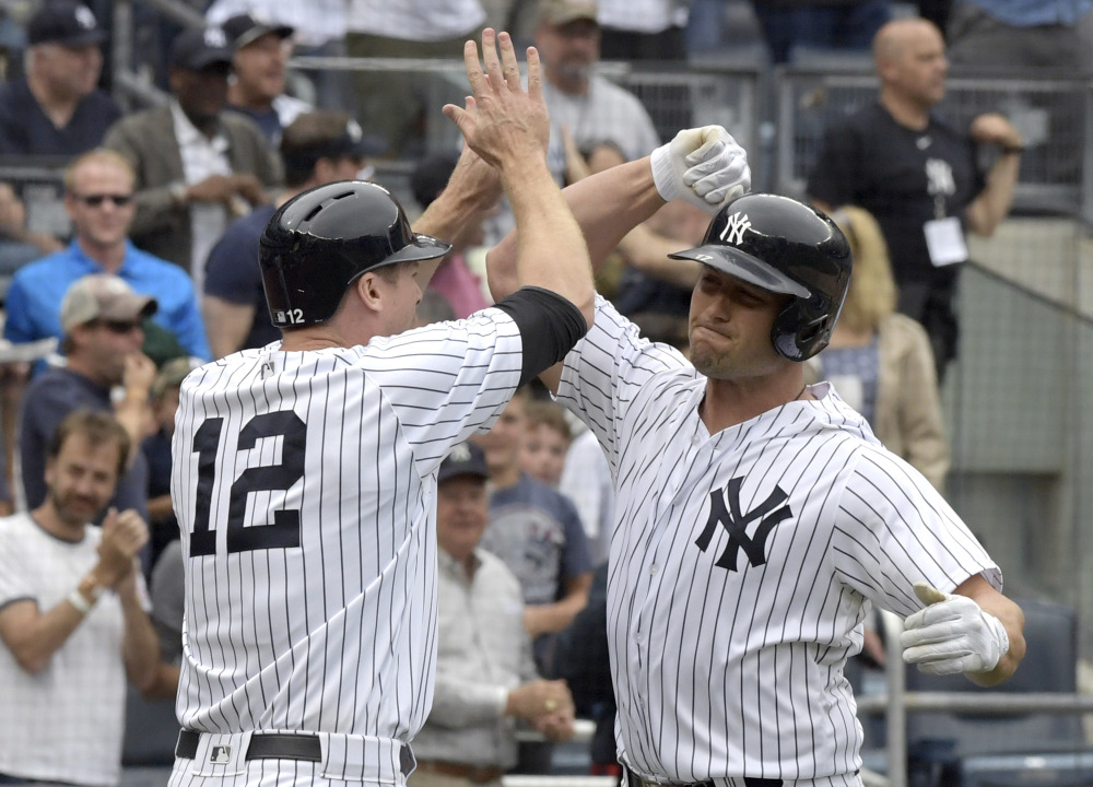 Matt Holliday, right, celebrates with Chase Headley after Holliday's three-run home run in the sixth inning of Saturday's game against the Red Sox at Yankee Stadium in New York.