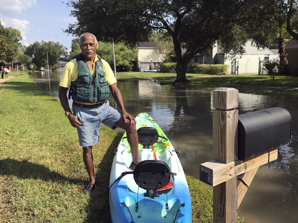 Gordon Prendergast's new kayak allows him to see how his house is faring after his Houston neighborhood was evacuated. He remembers when wilderness, not homes, marked the area.