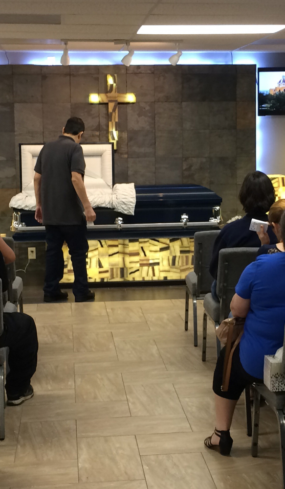 Mourners gather Friday for Harvey victim Benito Juarez Cavazos at Del Pueblo Funeral Home in Houston, days after the 42-year-old man was found dead amid receding floodwaters.