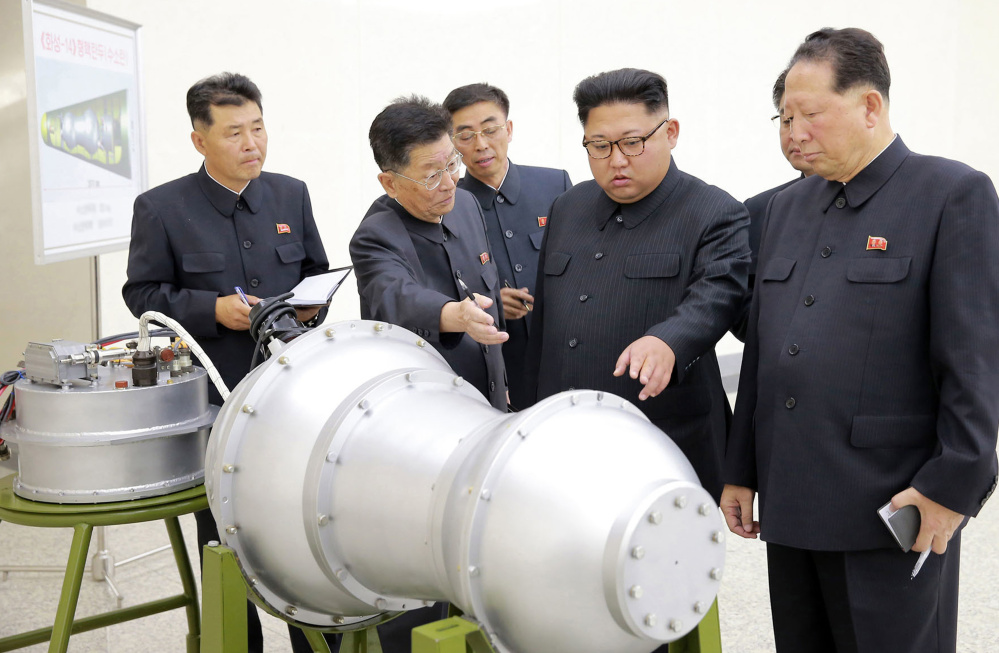 North Korea released this photo on Sunday of leader Kim Jong Un inspecting what it said is a hydrogen bomb that could be loaded onto a ballistic missile.